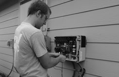 Solar Electrician checking the voltage of a solar inverter