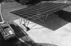 elevated solar panels making a carport