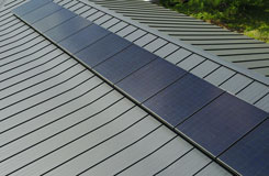 All black solar panel installation on a black metal roof in Austin