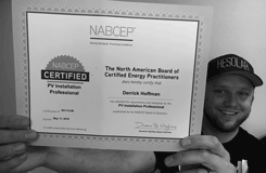 Derrick Hoffman displaying his NABCEP Solar Installer Certificate