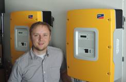 he solar owner Derrick Hoffman standing next to sma battery inverters