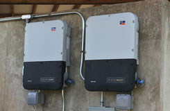 2 sma string inverters mounted on a concrete wall