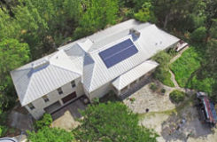 Solar Panel Cost displayed on a metal roof in Dripping Springs TX